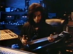 Prince - Playing bass in the studio (pinterest.com)